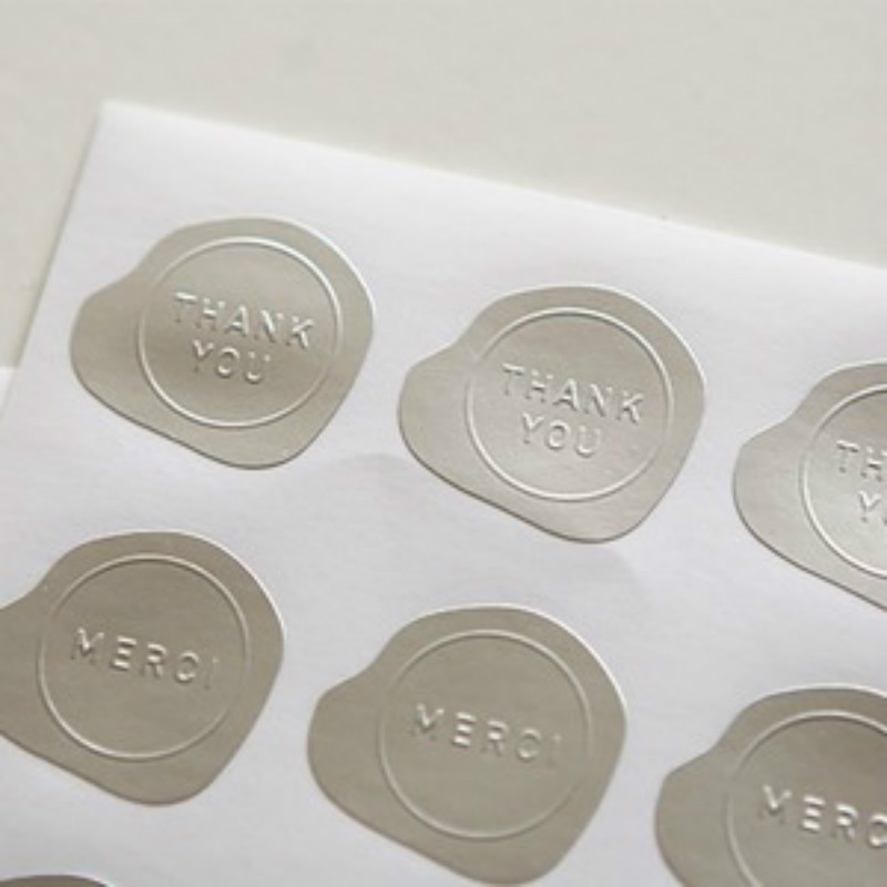 Small oval metallic silver embossed adhesive label sticker