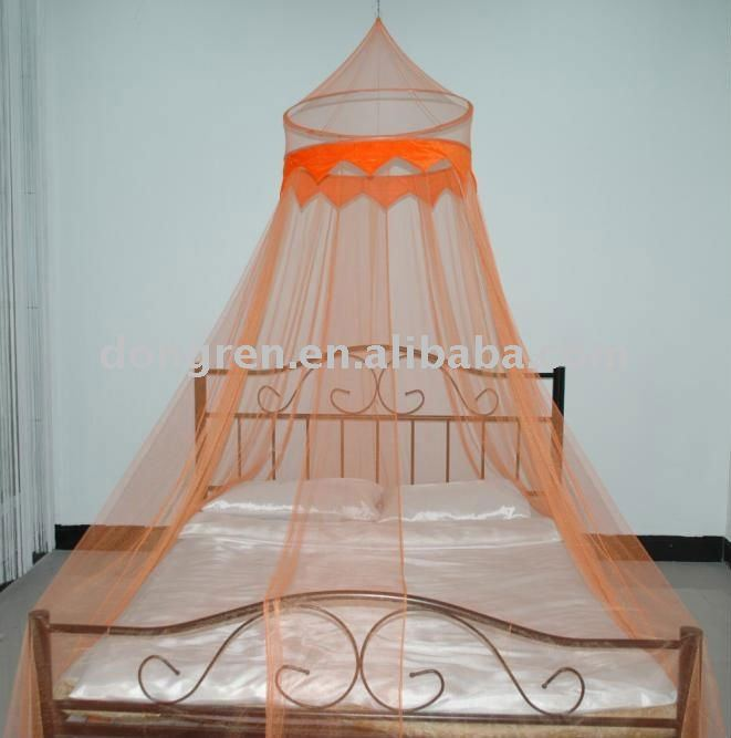 Circular bed canopy with decorative fabric and beads