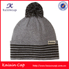 hot sell knitted winter pom pom bulk cheap beanie hats with custom label wholesale alibaba