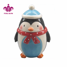 Penguin shaped ceramic canister cookie jar