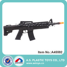 Boy play cool black plastic weapon gun with sound