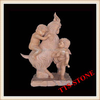 Red marble goat with children statue