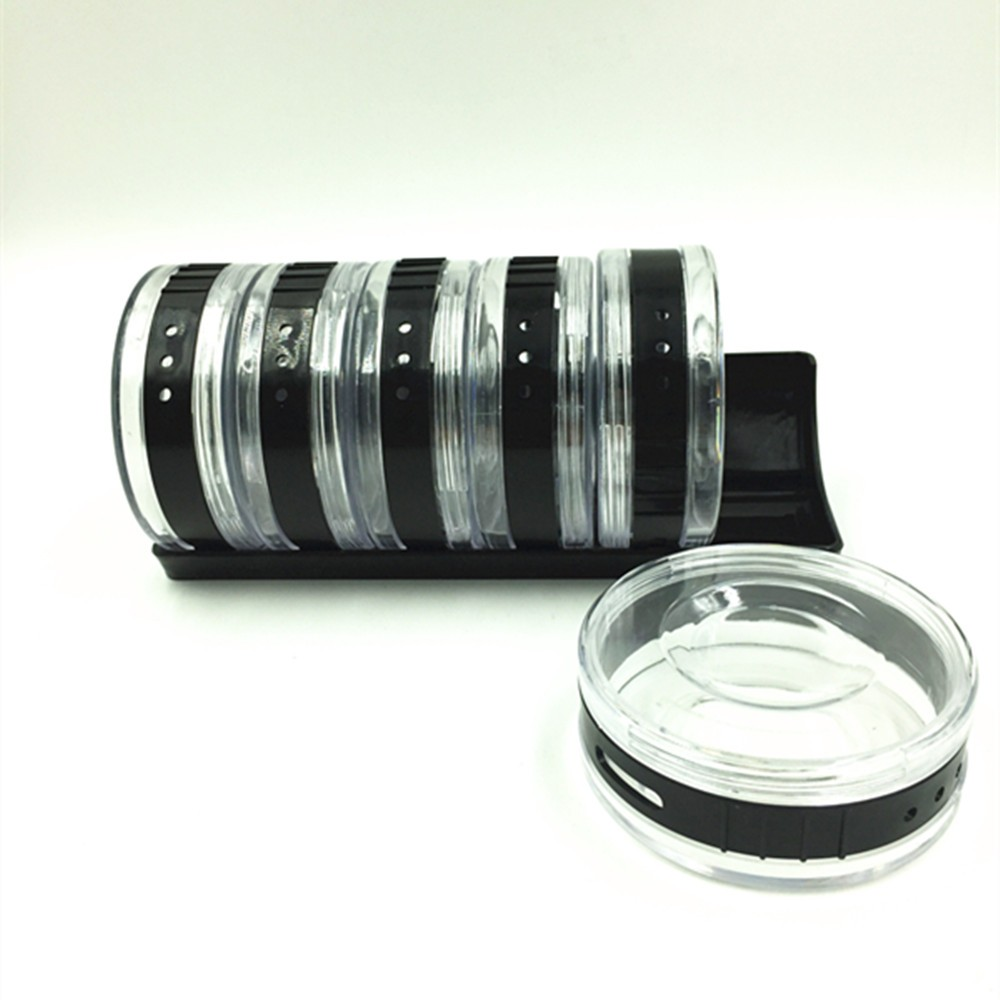 brand new unique plastic round cylindra condiment storage spice rack in black for kitchen tool