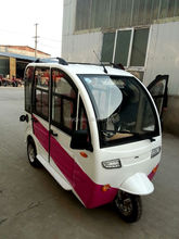 Enclosed electric tricycle