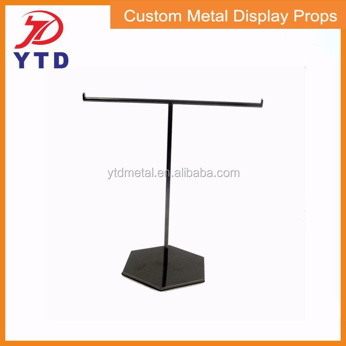 Metal holding stand for hand bag display