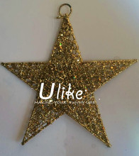 Golden glitter decorated set of lucky paper star ornaments for Christmas tree decoration