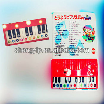 The multi-function children book with piano keyboard and drawing borad