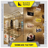 Brand clothes shop display furniture ,stainless steel hanging display rack, lady's clothes display fixture