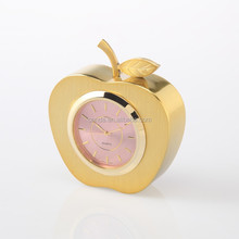 Metal desktop clock with apple shape