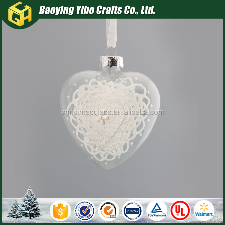 Clear glass heart shaped ornamnet hanging christmas tree