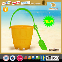 Summer holiday sand beach toy shovel and plastic buckets