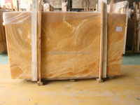 Luxury marble polished China natural yellow onyx stone price for floor tile