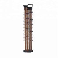 Rotating wooden glasses display stand holding 80 pairs sunglass with metal hooks and casters