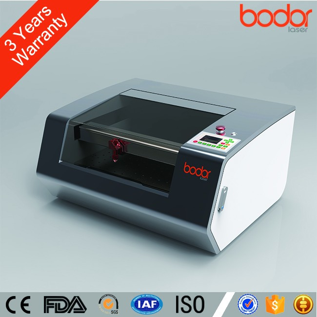 China CO2 laser cutting and engraver machinery for Leather and cloth