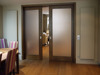 Two panel glass pocket door interior with pocket frame and hardwares