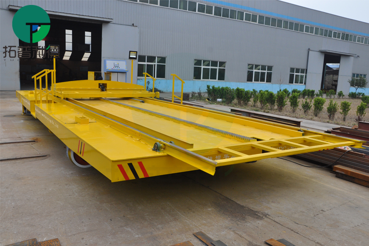 Busbar powered flatbed truck with rail for shipyard transport