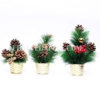 Plastic Christmas tree props with potted gold base and red foam berry festival decoration