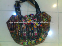 tribal ethnic bags with embroidery, tassels, pom-pom and coin