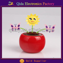 red apple solar flower pot with butterfly