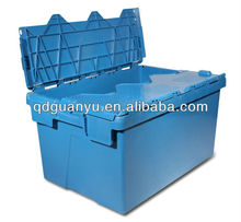 Plastic storage crate with attached lid