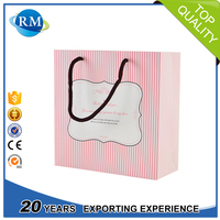Glossy laminated handled style Pink paper bags for shopping