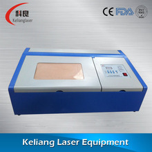 cheap 40w co2 kl-320 mini laser engraving machine for making rubber stamp/ rubber sheet