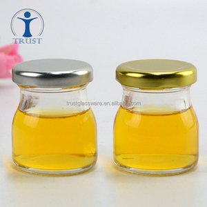 China Factory Wholesale High Quality Machine Made 2 oz Clear Transparent Honey Glass Jars With Lid