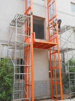 Heavy Duty Fixed Guide Rail Lift Platform Cargo Elevator in Use