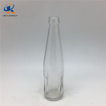 2017 hot sale clear cola shaped carbonated beverage glass bottle with crown cap