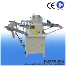 Automatic window film cutting machine with elevating material rack