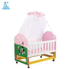 Lovely Pink Color Baby Rocking Bed Junior Bed Cot With Cabinets