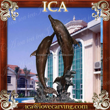 Classic bronze fountain of dolphins rising and twisting above the waves
