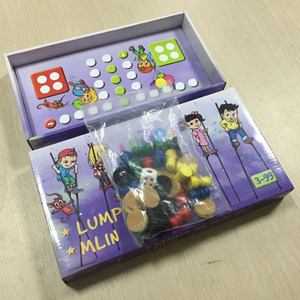 Child board game with wooden pawns and dices