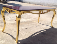 Top quality dining room furniture wooden table with gold foil finish legs.