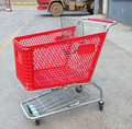 Metal shopping trolley with red plastic baskets