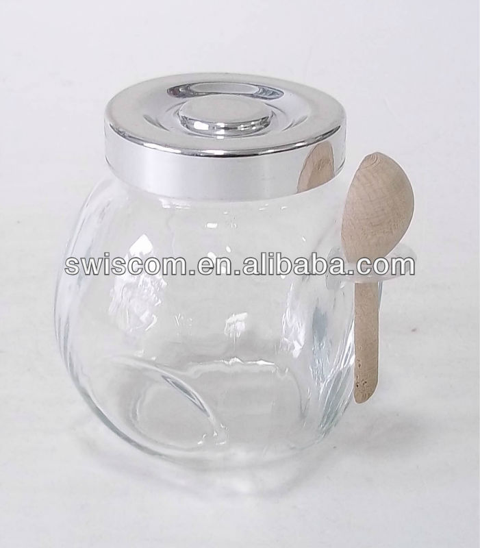 glass jar with plastic lid and wooden spoon