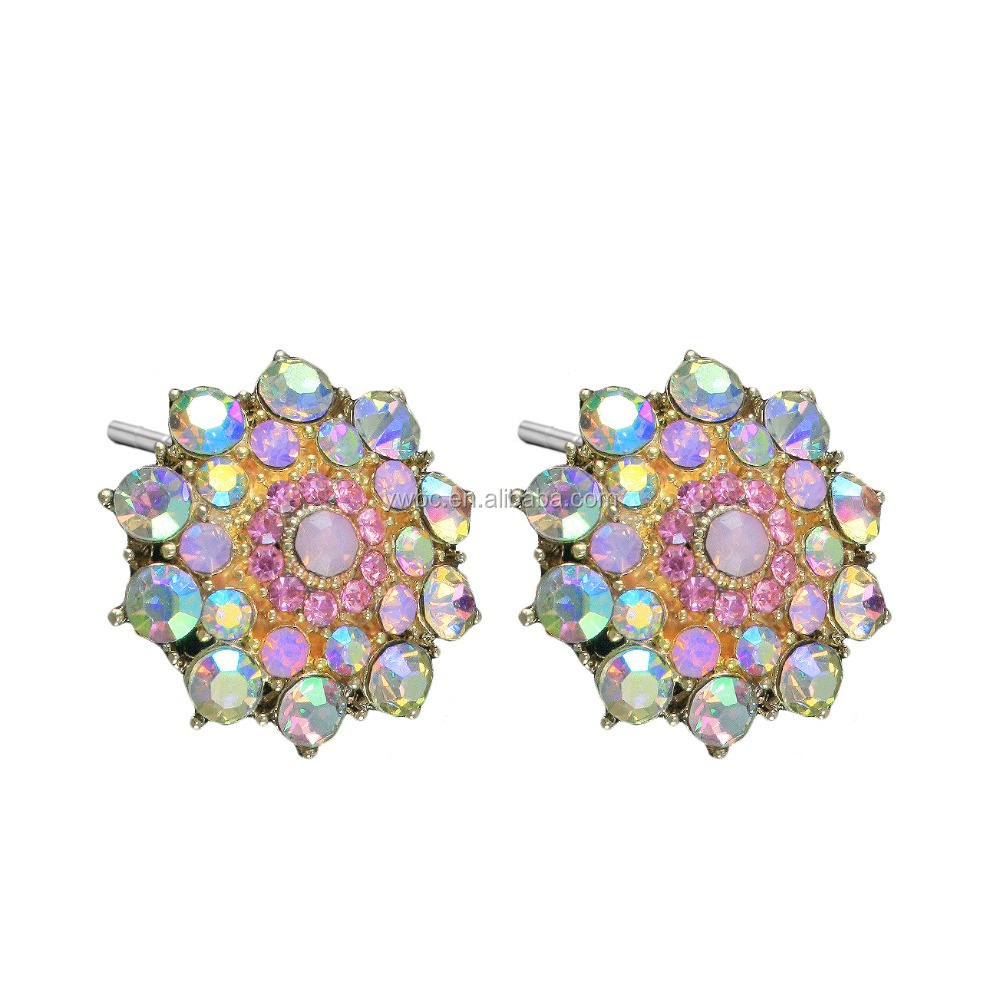 Gold tone pieced ear rose design earrings are decorated with aurora borealis crystal petals and rose crystal stud earrings