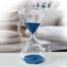 Decorative elegant and unique clear hourglass with coulor sand inside