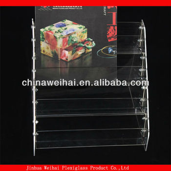 disassembled clear acrylic counter brochure holder