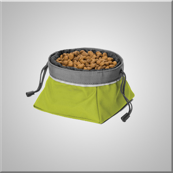 Dogs cage with food bowl easily fits in a pocket or backpack