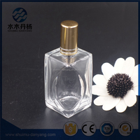 Beautiful design 60ml clear glass perfume bottle with atomizer spray for sale