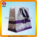 Colorful shopping paper bag with ribbon rope