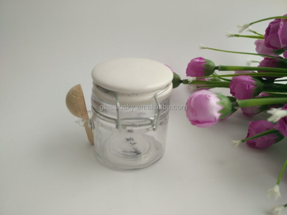 KW6602SS cheap swing top wholesale glass jar with spoon and ceramic lid for spices