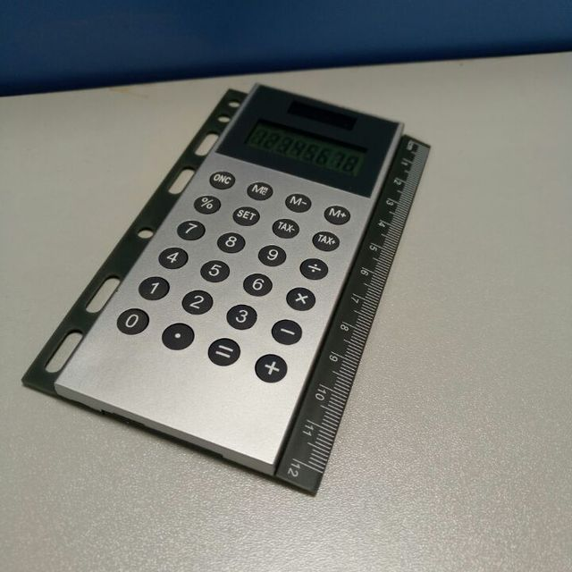 Dual powered calculator with measurement for leather portfolios folder