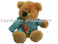teddy bear in blue outfit