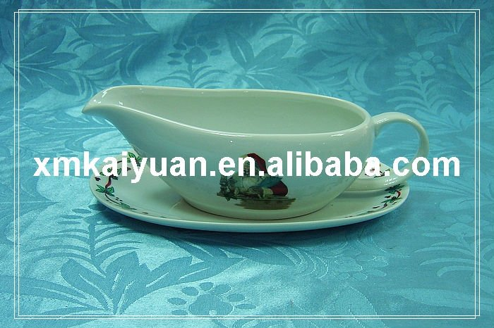 Christmas ceramic gravy boat with oval saucer