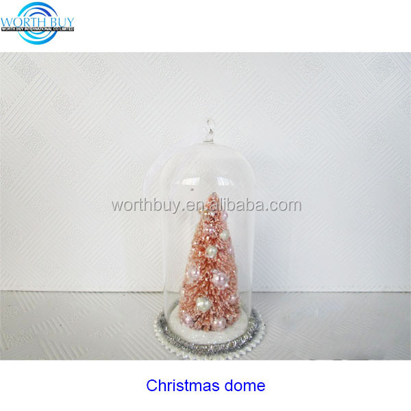 Pink Christmas tree in decorative mini glass dome