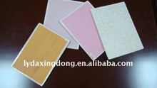 Coated gypsum ceiling tiles
