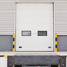 Long steel hand chain available overhead insulated door has optional of small windows