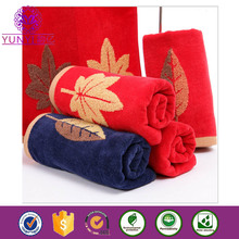 70cm*140cm low price promotional plain terry jacquard 100% cotton bath towel
